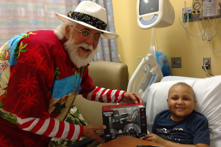 Santa visits a boy at the Children's Hospital at Palms West.